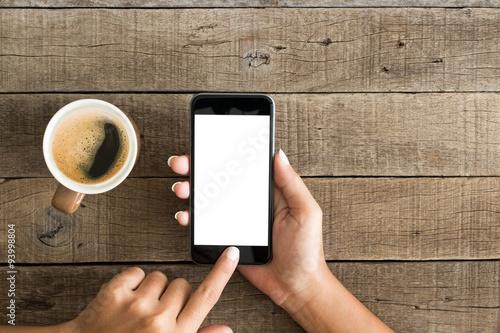 Main téléphone écran blanc en utilisant la vue de dessus Poster