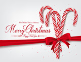 Merry Christmas Greetings in Realistic 3D Candy Cane and Christmas Balls in Background. Vector Illustration