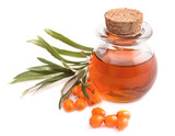 Small bottle of sea buckthorn oil and berries isolated on white
