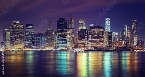 Vintage toned Manhattan skyline at night, NYC, USA.