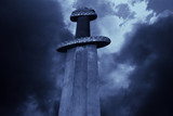 Medieval viking sword against a dramatic sky