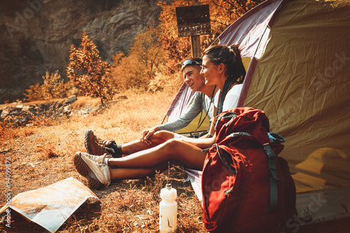 Couple camping. Young couple sitting in tent and relaxing.