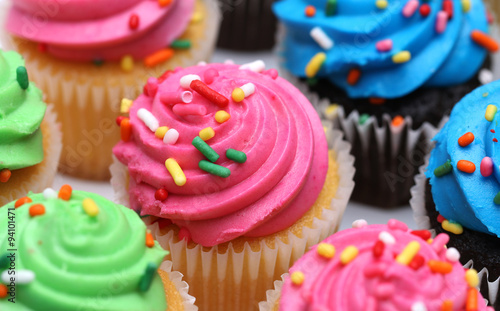 fototapeta na ścianę Multicolored Cupcakes Isolated on a White Background