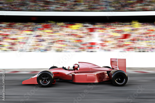 Fotografiet Motor sports red race car side view on a track leading the pack with motion Blur.