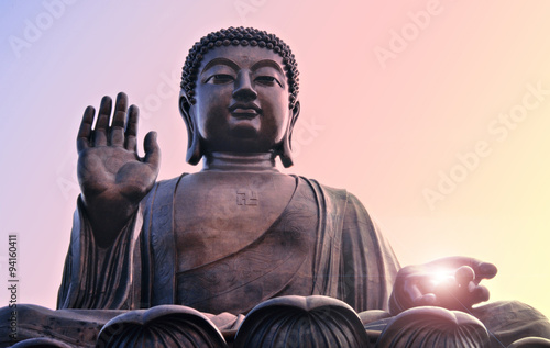 Aluminium Boeddha Buddha statue at Po Lin, Hong Kong. Bright light from hand.