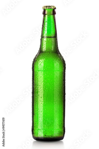 Bottle of beer with drops isolated on white