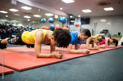 Fit people working out in fitness class Poster