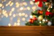 Obrazy na płótnie, fototapety, zdjęcia, fotoobrazy drukowane : empty wooden surface over christmas tree lights
