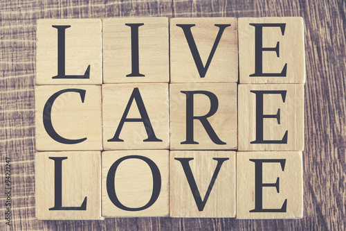 Live Care Love message formed with wooden blocks Poster