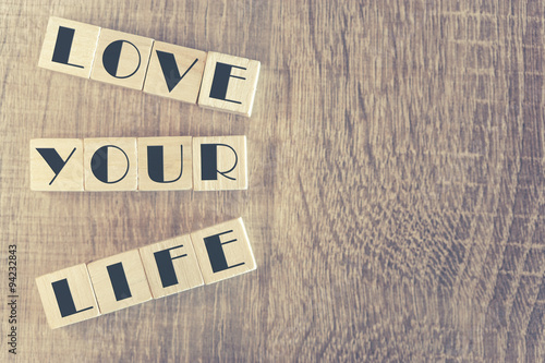Wooden letter cubes forming Love Your Life message Poster