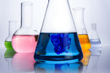 chemistry laboratory equipment and blue drop