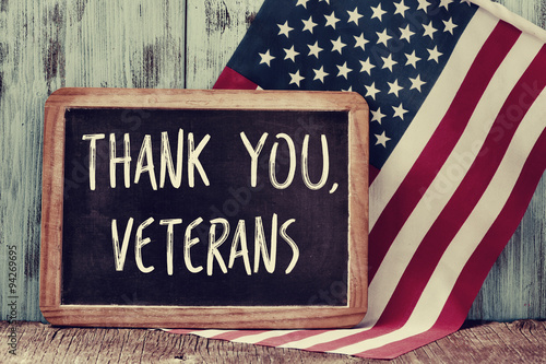 text thank you veterans in a chalkboard and the flag of the US