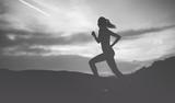 Woman running at nature - 94278000