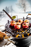 Fototapety Tasty stuffed apples roasting on a grill