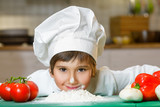 Fototapety Funny happy chef boy cooking at restaurant kitchen and bent over