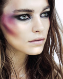 young beauty woman with makeup like shiner on face close up poster