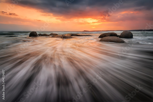 Fototapety, obrazy : Sea sunrise. Stormy sea beach with slow shutter and waves flowing out