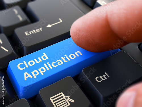 Pressing Blue Button Cloud Application on Black Keyboard.