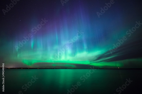 Fotobehang Noorderlicht Northern lights over lake in finland