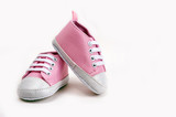 Fototapety Pink baby girl shoes on a wooden floor outdoors
