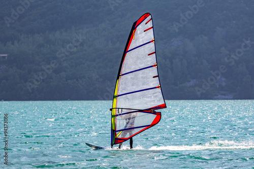 obraz lub plakat Windsurfer on the lake