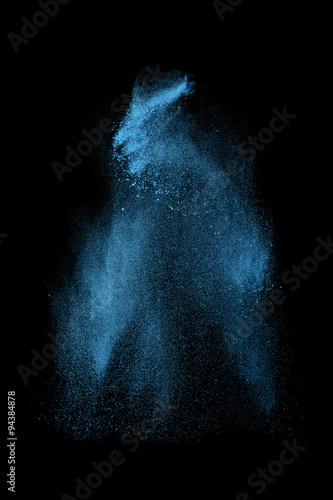 Leinwandbild Motiv Abstract design of blue powder cloud against dark background
