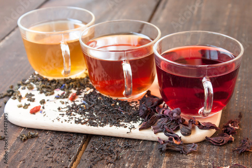 Papiers peints The Three glass cups of tea on wooden boards