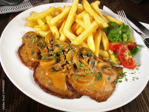 j gerschnitzel mit pommes frites stock photo and royalty free images on pic 94498887. Black Bedroom Furniture Sets. Home Design Ideas