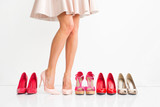 Woman choosing the right shoes - 94504259