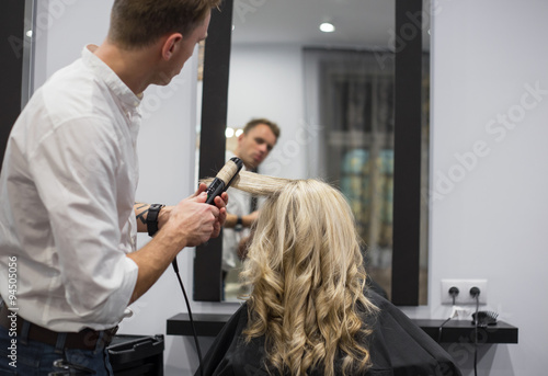obraz lub plakat Hairdresser working in hair salon