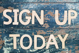 Sign up today written on rustic wooden surface