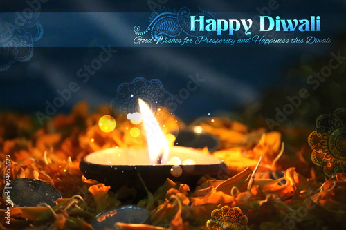 Diwali diya on flower rangoli Poster