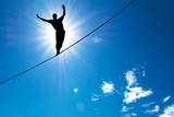 Silhouette of man balancing on the rope concept of risk taking - 94612053