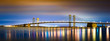 Delaware Memorial Bridge by night, viewed from New Jersey. The Delaware Memorial Bridge is a set of twin suspension bridges crossing the Delaware River between the states of Delaware and New Jersey
