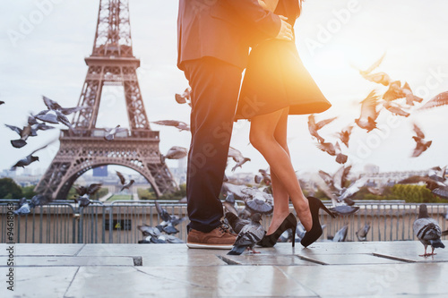 Fotografiet couple near Eiffel tower in Paris, romantic kiss