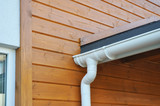 Closeup of problem areas for bitumen membrane rain gutter waterproofing and plastic drain downspout system. poster
