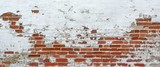 Texture Of Old Whitewashed Grungy Brick Wall With Peeling Plaste