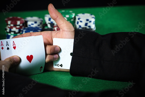 Man with ace up his sleeve, cheating at poker. плакат