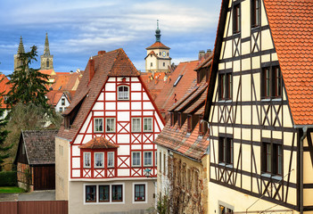 Traditional red tile roofs and half-timbered houses in Rothenbur