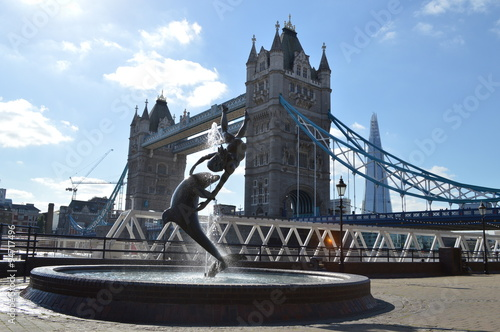 Tower Bridge with Dolphin and child statue