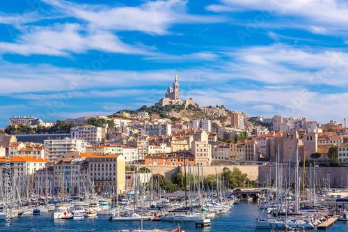 Fotobehang Schip Notre Dame de la Garde and olf port in Marseille, France