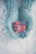Obrazy na płótnie, fototapety, zdjęcia, fotoobrazy drukowane : Woman hands in light teal knitted mittens are holding beautiful glossy red heart on snow background. Love, St. Valentine concept