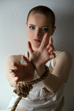 Crazy-looking girl posing with hands tied