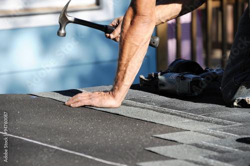 handyman working on repairing roof