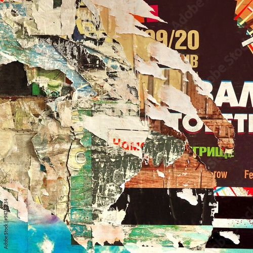 Old Billboard With Torn Paper Posters Background and Texture