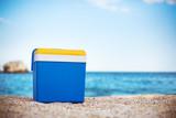 Cooler box on the sand beach - Fine Art prints