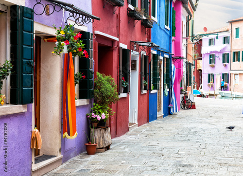 Obraz na Szkle street with multi-colored bright houses on Burano's island, Venice, Italy
