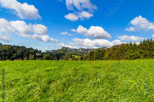 Foto op Canvas Pistache Panoramic landscape of colorful yellow-green hills, blue sky and clouds