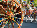 Close up view of a colorful wheel of a typical sicilian cart during a folkloristic show - 94805036