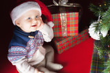 Christmas baby sitting near christmas tree and gift box!
